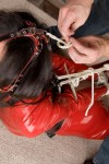 Ashley Renee hogtied in red latex catsuit