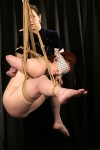 Young submissive Claire Adams in bondage