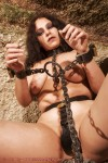 Chubby naked slave humiliated outdoors and enslaved in chains