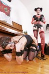 Mistress using tied slavegirl as a chair
