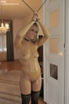Young slave Kitty naked in bondage