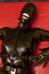 Pupett chained completely in latex