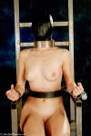 Nude slave restrained and hooded