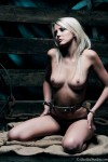 Blonde slave restrained in a cold steel