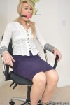 Secretary Katie bound and gagged in the office